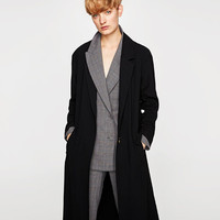 FLOWING TRENCHCOAT WITH STRAPSDETAILS
