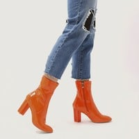 Hydro Statement Heel Sock Fit Ankle Boots in Orange Patent