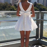 Approach Tie Bow Off White Bow Back Dress from xeniaeboutique