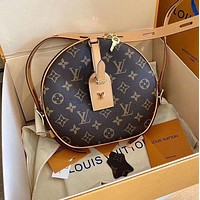 LV Louis Vuitton canvas women's round cake bag shoulder bag