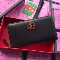 Gucci Leather zip around wallet