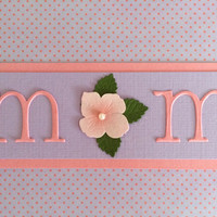 Mother's Day Pink and Purple with M O M in Pink Letters with a Pink Flower adorned with Pearls