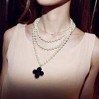 Limited Edition Pearl Necklace with Black Clover Design