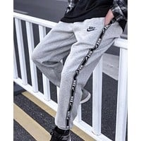 NIKE New fashion string mark print sports leisure pants Gray