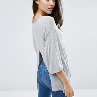 ASOS Top with Kimono Sleeve and Split Back in Oversized Fit at asos.com