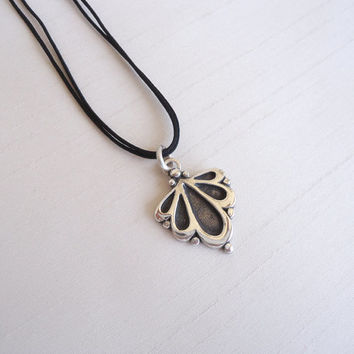 Sterling Silver Flower Pendant, silky cotton necklace - Iconic Floral Necklace - Contemporary Jewelry - Delicate and original
