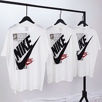 NIKE Summer New Fashion Letter Print Women Men Top T-Shirt White