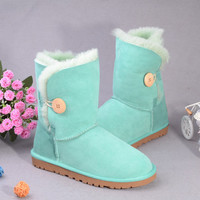 Aussie sheep fur snow boots Aqua buttons in tube flat sole by ClothLess