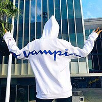 Champion sells a trendy hoodie with a big print print on the back and arms