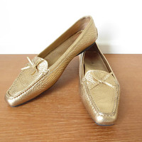 Prada gold pebbled leather moccasins, size 10 Made in Italy