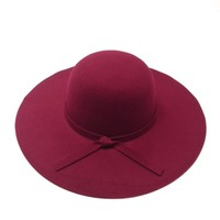 This hat is great for looking chic and put together and it is also a great way to battle bad hair days in winter. Featuring a felt floppy round crown, and wide floppy brim. Finished with knotted band embellishment. Pair with cropped top, bell bottom and fr