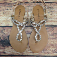 A TWIST OF FATE SANDAL IN NATURAL