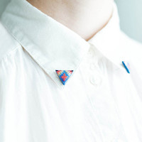 Blue and red collar brooches