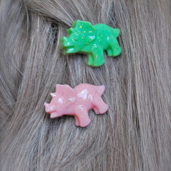pair of sparkly pastel kawaii triceratops dinosaur hair clips