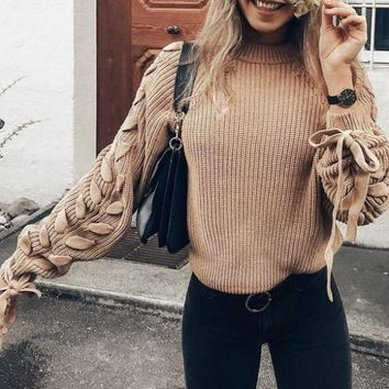 Women lace up knitted sweater