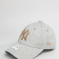 New Era 9Forty Cap in Gray Marl with Gold Embroidery at asos.com