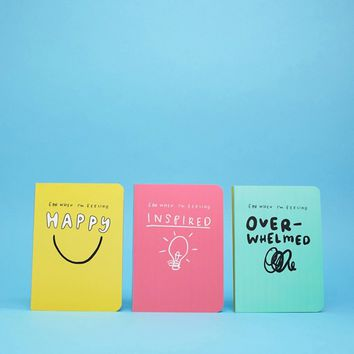 The Happy News pack of 3 journal notebooks at asos.com