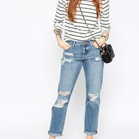 ASOS   ASOS Brady Slim Boyfriend Jeans in Avaline Mid Wash With Paint Effect at ASOS