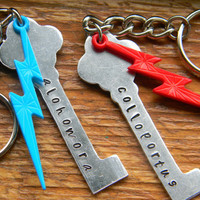 Harry Potter inspired skeleton key ring hand stamped alohomora or colloportus with colorful lightning bolt
