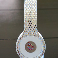 Beats Solo HD headphones covered in clear crystals with pink crystal accent.