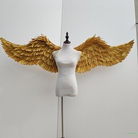 gold and silver plumes of angel wings
