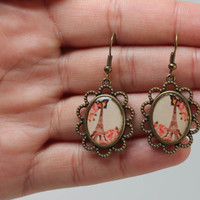 Handmade vintage oval unique earrings made of metal and glass glaze with a print