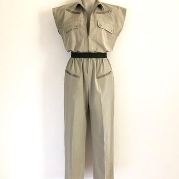 Vintage 1980s khaki zip front jumpsuit with elastic waist and zippered/press stud pocket details