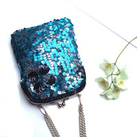 Blue and silver sequins evening, wedding clutch, silver kiss lock and hand embroidered black sequins flower.