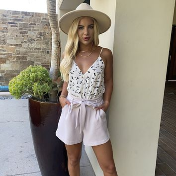 Chic in Pink Shorts with Matching Belt