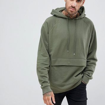 ASOS DESIGN oversized hoodie in khaki with map pocket at asos.com