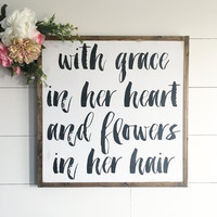 With Grace in Her Heart and Flowers in Her Hair Sign
