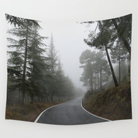 The road, the forest... Wall Tapestry by Guido Montañés