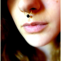 fake nose piercing with black bead