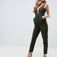 ASOS DESIGN cami jumpsuit with gold bar detail and plunge neck at asos.com