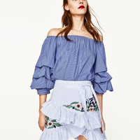STRIPED EMBROIDERED SKIRT DETAILS