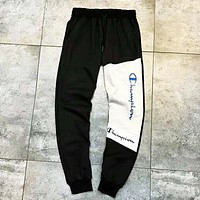 Champion New fashion embroidery letter splice contrast color couple pants Black
