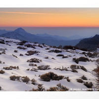 Orange sunset at the mountains. Sierra Nevada by Guido Montañés