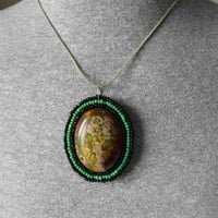 New Life Dragon Egg Pendant with seed beads and Sea Jasper Cabochon