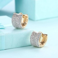Sterling Silver Baguette Channel-set Diamond Hoop Huggie Earrings 1/4