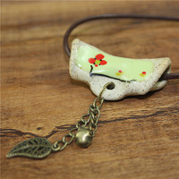 Ceramic flower necklace,Boho clay necklace,contemporary jewelry,rope,Natural vegan jewelry,porcelain pendant,hand painted,handmade