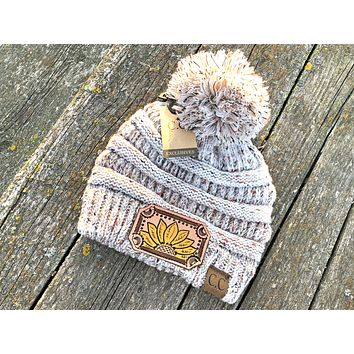 Oatmeal Tan Beanie Hat with Pom Sunflower Tooled Leather Patch Hat