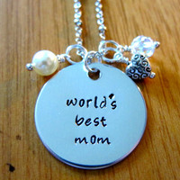 """Mother's Day """"World's Best Mom"""" Necklace. Hand stamped silver colored pendant, Swarovski crystal, pearl & charm."""