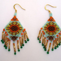Beaded earrings with sunflower pattern in diamond shape, gold bugle beads and green drops. Handmade