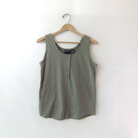 80s sage green cropped tank top with buttons down the front.