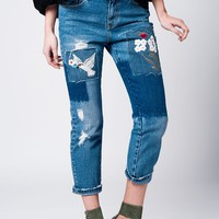 Denim mid wash blue jean with cloth and embroidered floral patches