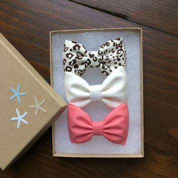 Cheetah, off white, and pink chambray hair bows from Seaside Sparrow.  Seaside Sparrow bows make the perfect birthday gift.