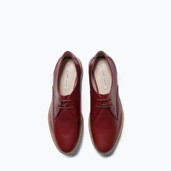 Wooden sole leather bluchers