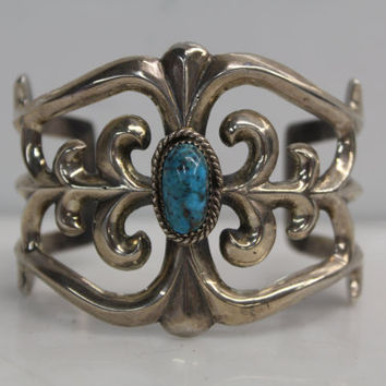 Vintage Old Dead Pawn Sterling Silver Cutout Curved Line Design cuff bracelet with Turquoise Stone In Center