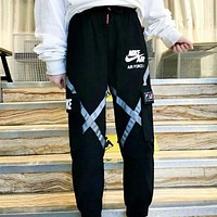 NIKE New fashion letter hook print couple pants Black
