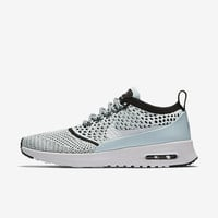 The Nike Air Max Thea Flyknit Women's Shoe.